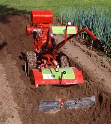 whether your garden is a small bed of cutting flowers or a big vegetable garden whose bounty is preserved for year around use there is a power tiller - Use Garden Tiller