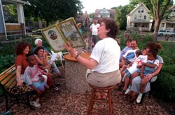 Author Jacqueline Briggs Martin reads one of her books during storytime. (Reprinted with permission from The Cedar Rapids Gazette, 7/17/97/)