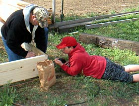 He-roes work together to build raised beds for the Garden of Eat'n.