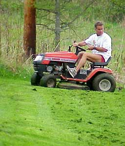 Lawn tractors employ multiple rotary blades to cut a 3- to 4-foot swath in one pass.