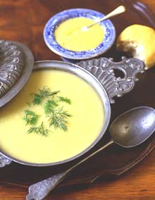 Parsnip-rhubarb soup topped with fresh dill. In the background, eggless lemon curd