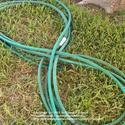 Roll Up Garden Hoses in Figure Eights