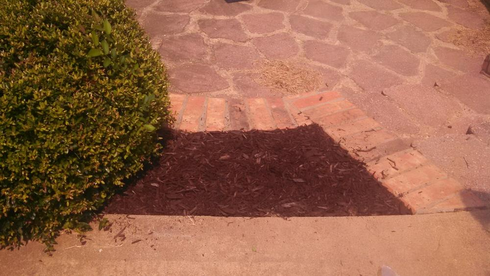 Lava mulch black lava rock mulch images lava mulch for Landscaping rock removal