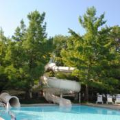 Location: Glen Ellyn, IllinoisDate: 2014-08-13trees at slide at public swimming pool